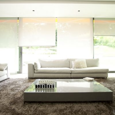 Loungeroom with sheer roller blinds