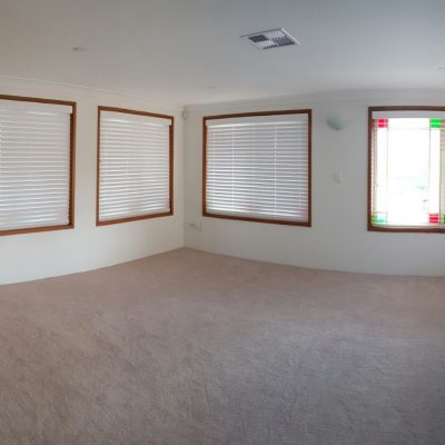 loungeroom with timberstyle venetian blinds